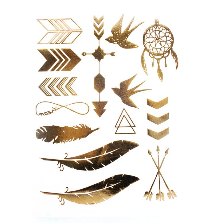 t-62_golden_tattoo_guldtatuering_idiwa_svala_dromfangare_pilar_fjadrar_1_webben